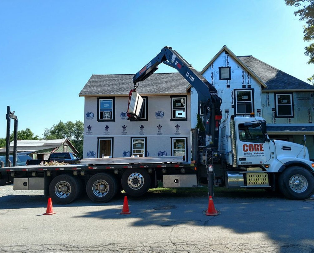 A truck working on delivery and demolition service at a home