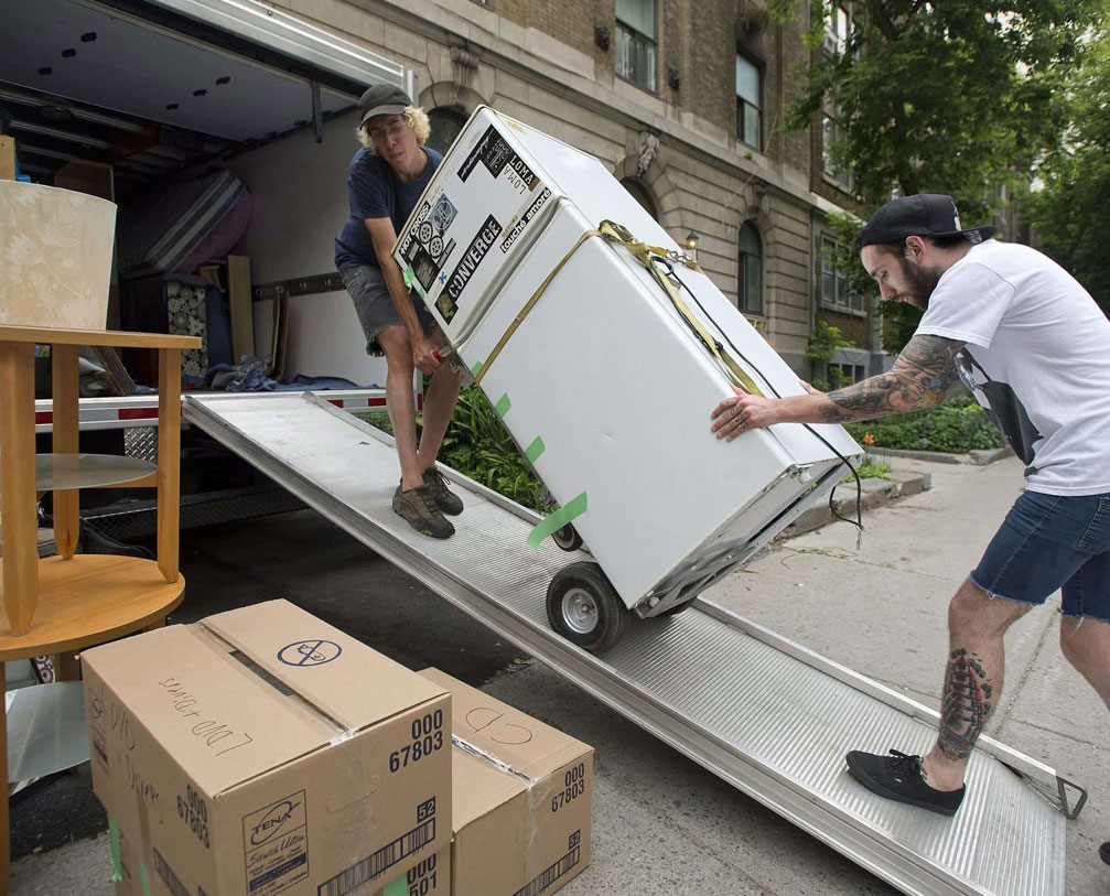 A refrigerator being loaded into a van for shifting