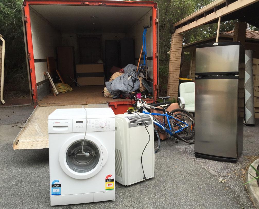 Washing machine,refrigerator,bicycle kept outside for moving